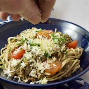 Spelt spaghetti with duck & fennel ragù, cherry tomatoes, parmesan & parsley