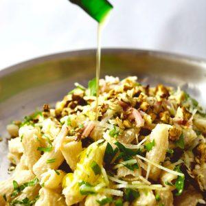 Spelt pasta rigatoni with celeriac puree, ham, parmesan and local walnuts